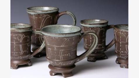 Ceramic mugs from Petke's collection.