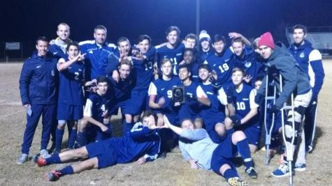 The boys varisty soccer team celebrates victory before preparing for state semis.