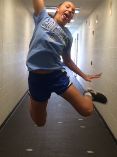 Soccer star Casey Ballow jumps for joy.