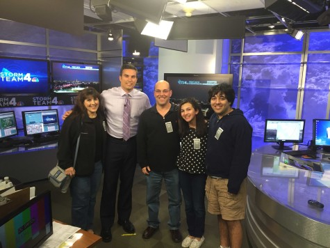 Solender and his family pose with the cast of NBC Washington news.