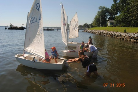 Maddie Mulligan coaching a racing fleet in Florida over the summer.
