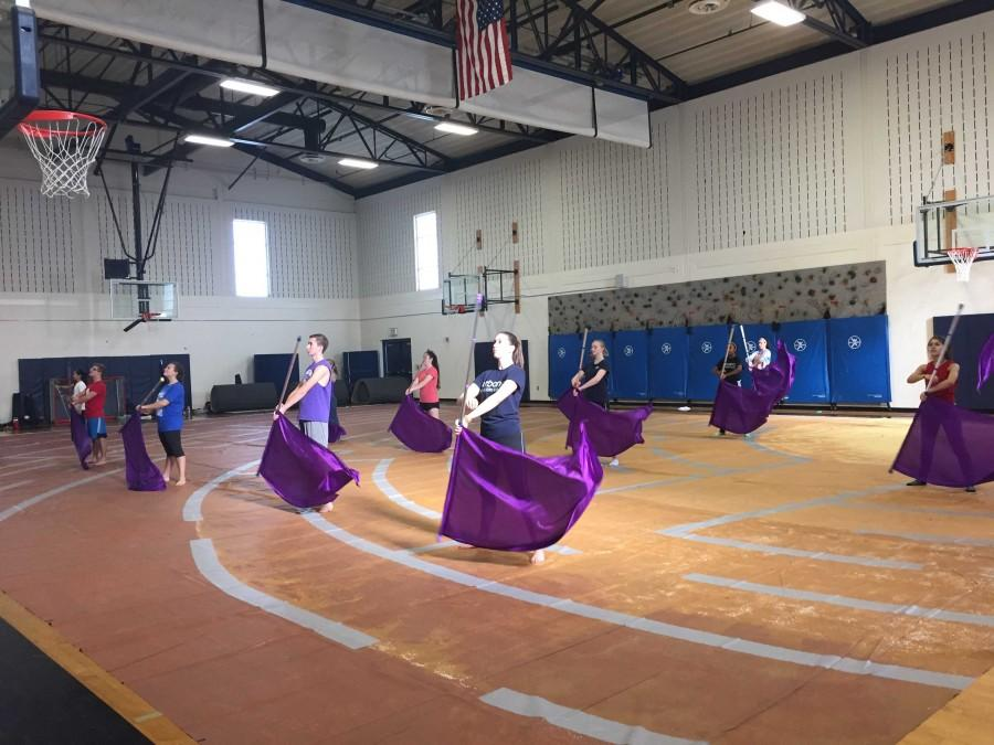 Winter Color Guard practices their performance to Dancing On My Own.