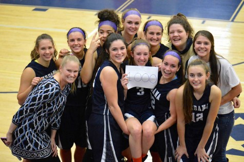 Lohr and her team  gathered together to celebrate her 1000th point milestone here at Urbana.