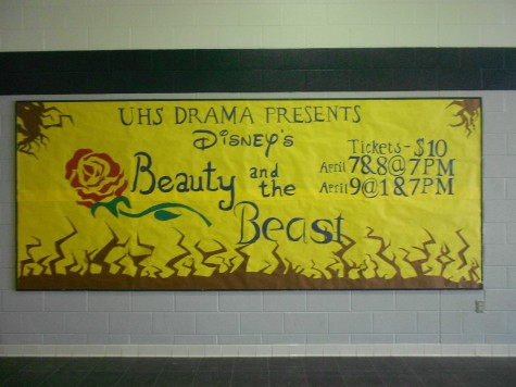 The Beauty and the Beast informative mural hangs in the auditorium prior to the show's opening night on April 7.