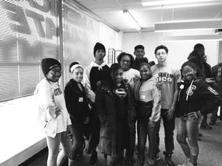 Ida Davis and a handful of students volunteer at the American Karate Academy.