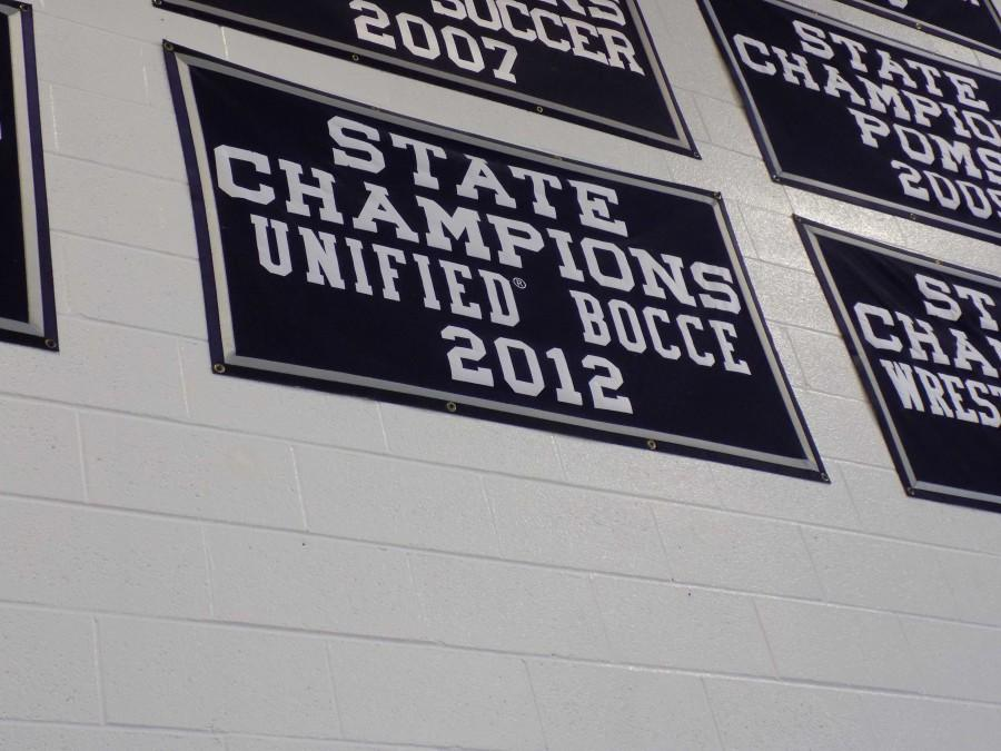 The Unified Bocce State Champions banner hangs high in the gym.