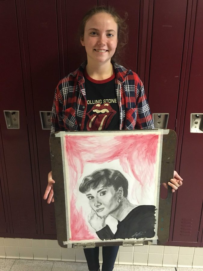 Senior Savana Bridges shows her art .