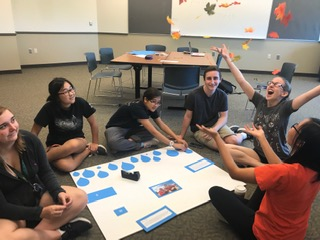 Members of the Thirst Project Club participate in creating a poster for their event at the Fall Festival. From left to right: Claire Sanford, Evelyn Sun, Calla Gentilucci, Andrew Celi, Gabi Snyder, Lily Larson
