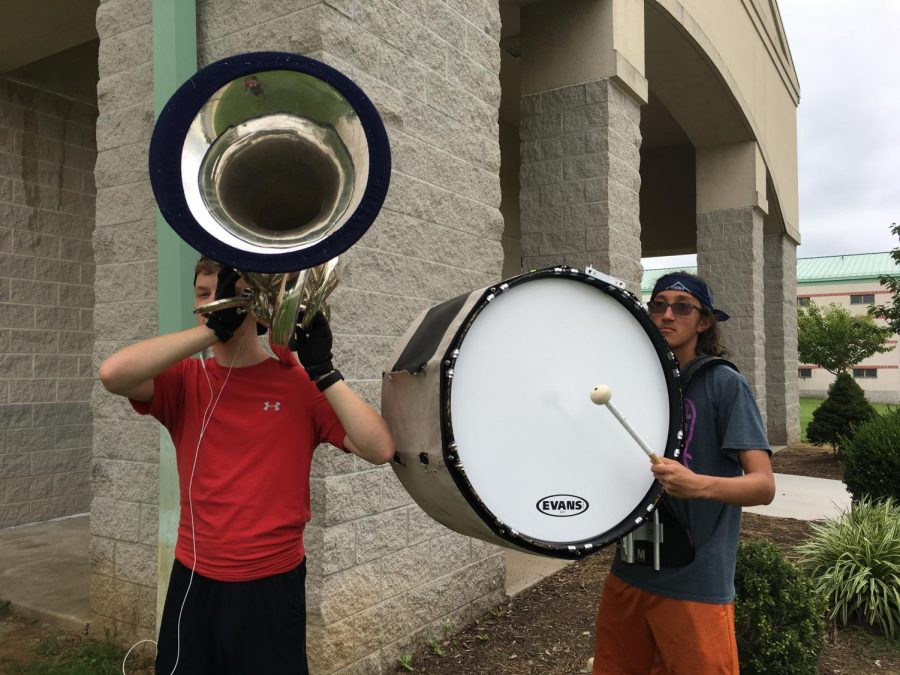 "Victor ""Ronnie"" Holmquist poses with a tuba and Dennis Clifford with a bass drum during band camp over the summer"