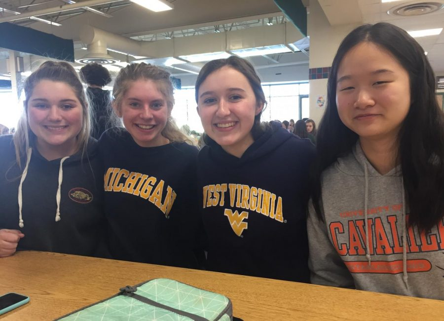 Photo of the Day 2/15:Students Participate in Spirit Day by Wearing their College Gear