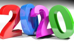 2020 is written with 3D colorful numbers standing on a white surface - 3D rendering illustration