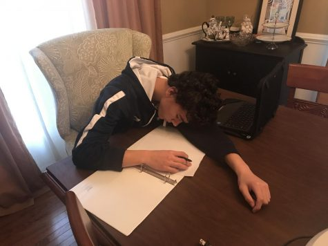 Photo illustration of freshman, Gavin Allanach, sleeping while doing homework.