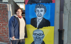Tobias Weichbrod (11) stands beside his completed mural at Mt. Airys Simpson-Baker-Bowlus pop-up park.